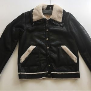 Faux leather and Sherpa lined Chaser jacket.